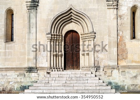 Ancient door in the Church photographed close up - stock photo