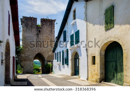 Ancient doorway in the French commune of Hastingues. - stock photo