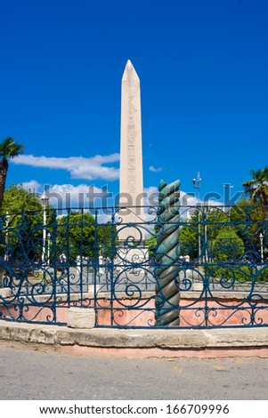 Ancient Egyptian obelisk of Pharaoh Tutmoses in Hippodrome square of Istanbul, Turkey - stock photo