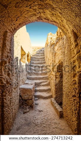 Ancient entrance to one of tombs of Paphos necropolis known as Tombs of the Kings, Cyprus. - stock photo