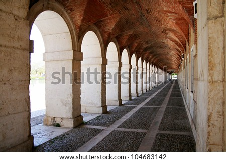 Ancient exterior hallway of Royal Palace in Aranjuez (Madrid,Spain) - stock photo