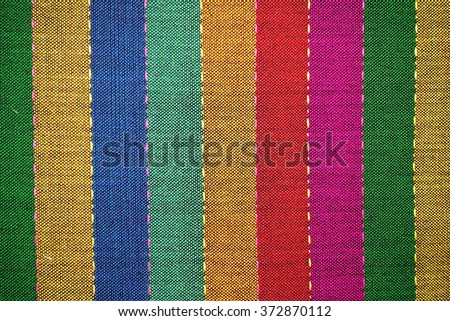 Ancient fabric colorful thai silk handcraft peruvian style rug surface close up textiles peruvian  beautiful background tapestry persian detail pattern farabic fashionable old                       - stock photo