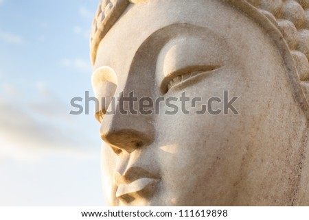 Ancient Face of a stone statue of Buddha