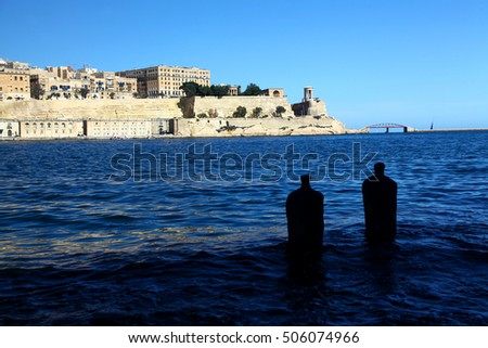 Ancient fortifications rise out of Grand Harbour, Malta. Former home of the Hospitaller Knights of St John.