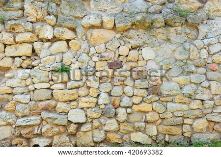 ancient fortress stone wall background - stock photo