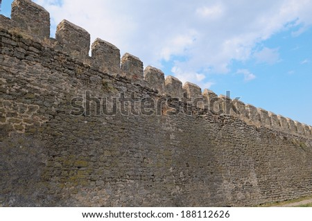 ancient fortress wall and blue sky - stock photo