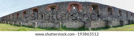 Ancient fortress wall with loophole protecting castle - stock photo