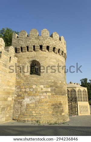 Ancient fortress wall with watchtower in Baku old town, Azerbaijan