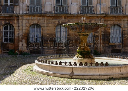 Ancient fountain in old part of Aix en Provence town, South France - stock photo