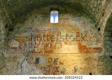 Ancient fresco paintings on the Medieval byzantine fortress of Mystras (UNESCO World heritage), near to historical city of Sparta. Greece. - stock photo
