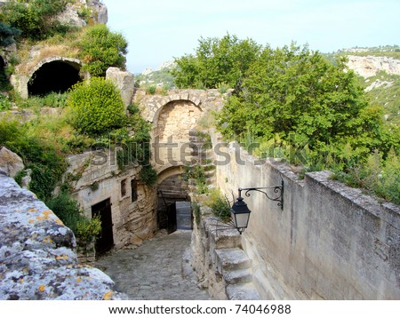 Ancient gate in the medieval walls of Les Baux de Provence, France - stock photo