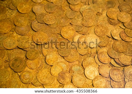 Ancient gold coins as background - stock photo