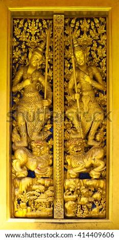 Ancient Golden carving wooden door of Thai temple in Bangkok - stock photo