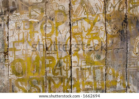 Ancient graffitti etched into the crumbling wood and plaster of historic timbered building in Rouen, France. - stock photo