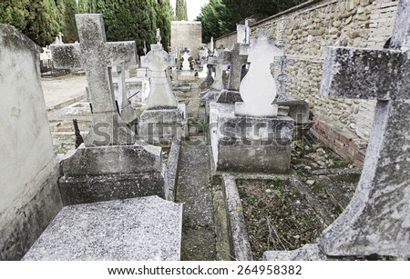 Ancient graves with crosses, detail of a Christian cemetery - stock photo