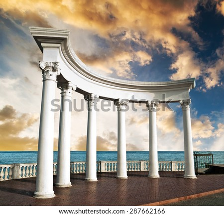 Ancient Greek columns at sunset - stock photo