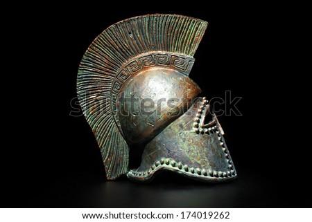 Ancient Greek Helmet Athenian Style in Low Key, Side View - stock photo