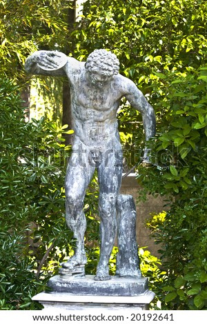 Ancient greek statue showing a disk thrower olympic athlete at Mon Repo palace in Corfu, Greece