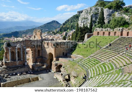 Ancient Greek theater is the most remarkable monument remaining at Taormina. This is one of the most celebrated ruins in Sicily. - stock photo