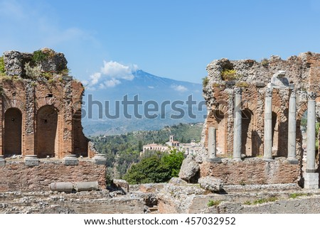 Ancient Greek theater of Taormina city with a panorama at the Etna at the island Sicily, Italy - stock photo