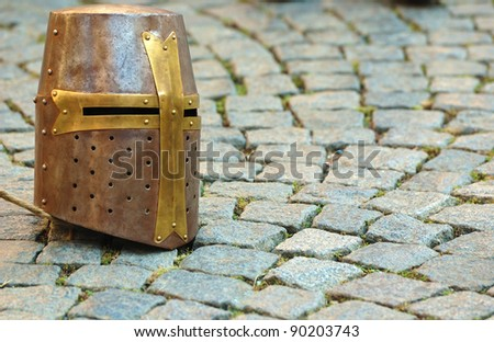 Ancient helmet, landscape - stock photo