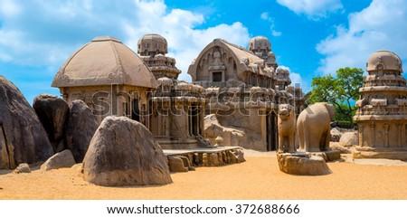ancient Hindu monolithic Indian rock-cut architecture Pancha Rathas - Five Rathas, Mahabalipuram, Tamil Nadu, South India, panorama - stock photo