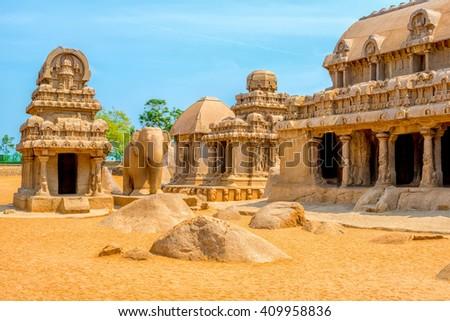 ancient Hindu monolithic Indian sculptures rock-cut architecture Pancha Rathas - Five Rathas, Mahabalipuram, Tamil Nadu, South India - stock photo