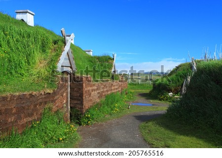 Ancient homes of Viking settlers in L'Anse aux Meadows National Historic Site on the island of Newfoundland, Canada - stock photo