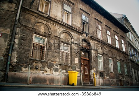 Ancient house and modern trash container in jewish district of Budapest, Hungary - stock photo