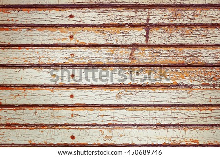 Ancient house with peeling paint on the wooden walls. - stock photo