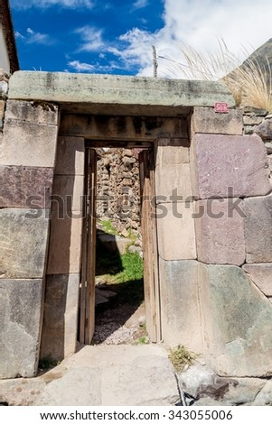 Ancient Inca style door of a house in Ollantaytambo village, Sacred Valley of Incas, Peru - stock photo