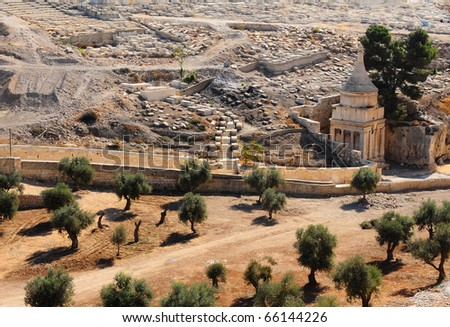 Ancient Jewish Cemetery on the Olive Mountain in Jerusalem and Absalom's Pillar - stock photo