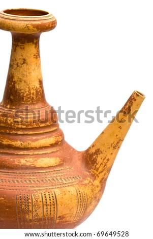 Ancient jug isolated on white background. - stock photo