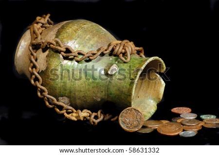 stock-photo-ancient-jug-with-coins-58631