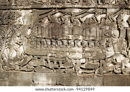 Ancient Khmer bas relief carving showing Cham fighters taking part in a naval battle on the Tonle Sap lake in Cambodia.  Bayon Temple, Angkor Thom, Siem Reap, Cambodia. - stock photo