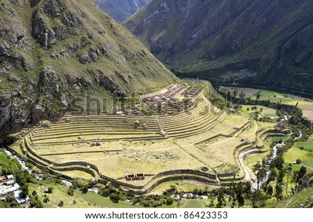 Ancient Llactapata Inca Ruins on the Inca Trail situated at the bottom of Urubamba valley with river - stock photo