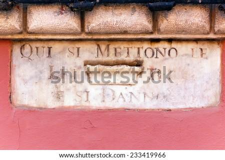 Ancient Mailbox - Carrara Tuscany Italy / Historical mailbox in white marble in Carrara, Tuscany, Italy - stock photo