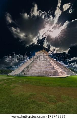 Ancient Mayan civilization historical ruins of pyramid,  at night. Kukulcan Temple at Chichen Itza, Yucatan, Mexico. Fantasy. - stock photo