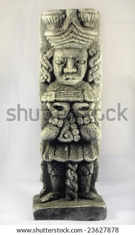 Ancient Mayan sculpture of an old Mayan god - stock photo