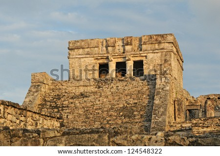 Ancient Mayan Temple Ruins agains blue and cloudy sky in Mexico - stock photo