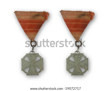 ancient medal with red ribbon from 1916 - stock photo