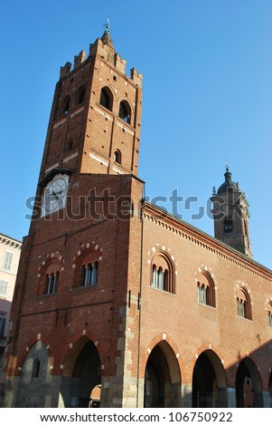 Ancient medieval Arengario palace on blue sky, Monza, Lombardy, Italy - stock photo