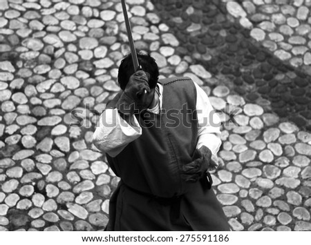 ancient medieval soldier with sword during the final duel - stock photo