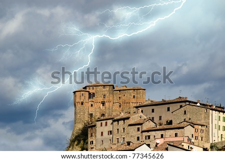 ancient medieval town under the storm - stock photo