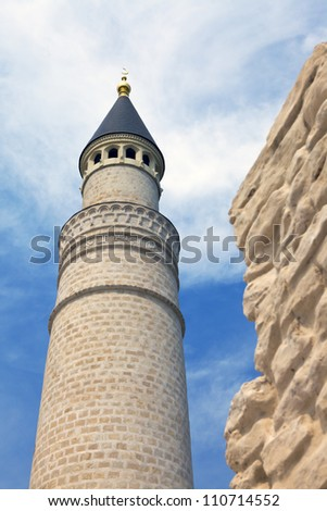 Ancient minaret of limestone - stock photo