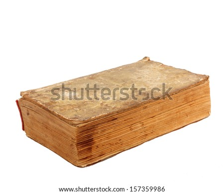 Ancient Old lacerated book on a white background isolated - stock photo