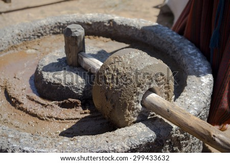Ancient olive oil production machinery, stone mill and mechanical press, oil mill for olives - stock photo