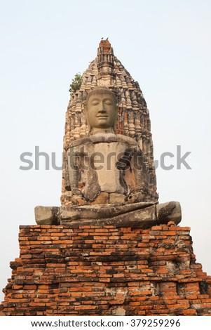 Ancient pagoda and buddha statue at thailand - stock photo