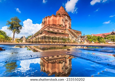 Ancient pagoda at Wat Chedi Luang temple 700 years in Chiang Mai, Asia Thailand, They are public domain or treasure of Buddhism, no restrict in copy or use  - stock photo