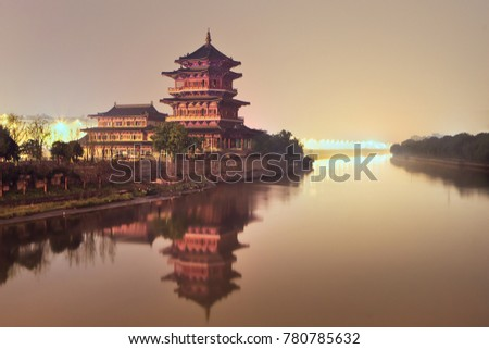 Ancient pagoda beside a quiet river during twilight, Nanjing, China